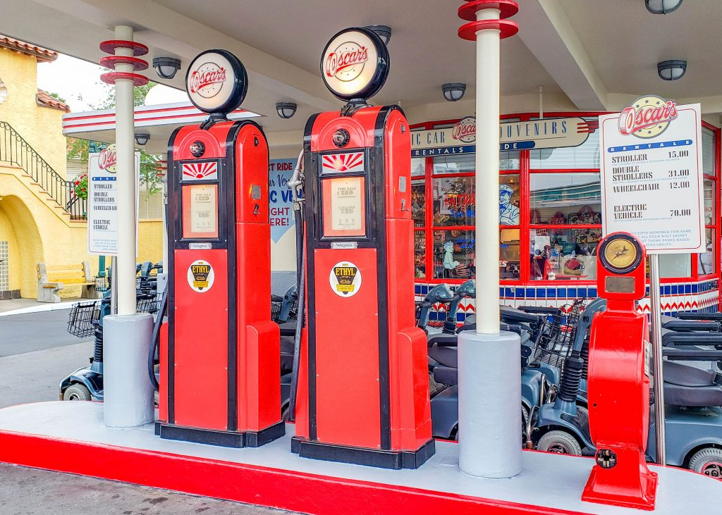 The red gas pumps with black trip at Oscar's Stroller Rental at Hollywood Studios.