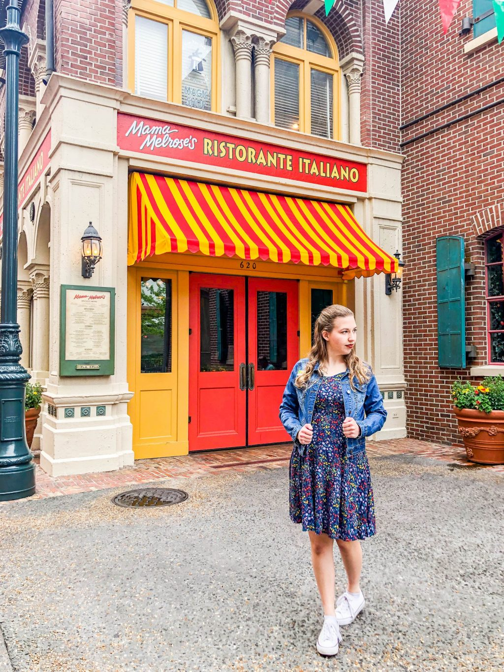 Girl stands outside of Mama Melrose's restaurant in Disney's Hollywood Studios.